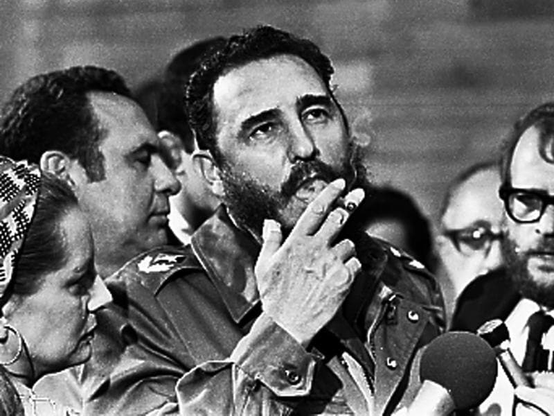 Then Cuban Prime Minister Fidel Castro smokes a cigar during interviews with the press during a visit of U.S. Senator Charles McGovern, in Havana in this May 1975 file photo.  (REUTERS)