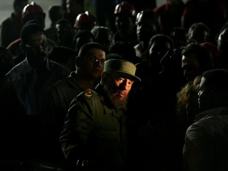 Then Cuban President Fidel Castro looks at a news ticker flashing on the front windows of the U.S. diplomatic mission while visiting the construction site outside the mission in Havana in this January 25, 2006 file photo.  (REUTERS)