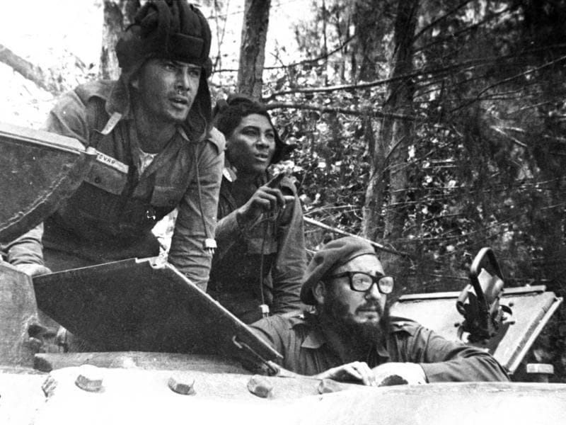 In this April 1961 file photo, Cuba's leader Fidel Castro, bottom, looks out from a tank during the Bay of Pigs invasion in Cuba.  (AP)
