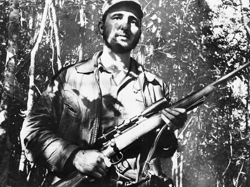 In this February 26, 1957 file photo, Cuba's leader Fidel Castro stands in an unknown location in Cuba.  (AP)