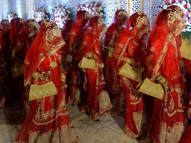 Brides arrive for a mass marriage in Mumbai on November 23, 2016. Twenty two couples were wed in the ceremony organised to help economically backward families who otherwise cannot afford to pay for a wedding.  (Indranil Mukherjee/AFP)