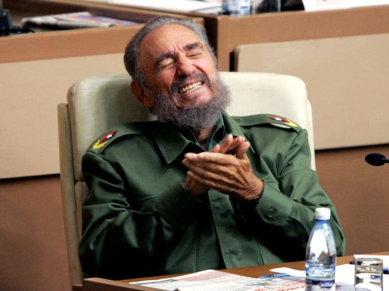 Then Cuban President Fidel Castro laughs during the year-end session of the Cuban parliament in Havana in this December 23, 2005 file photo.  (REUTERS)