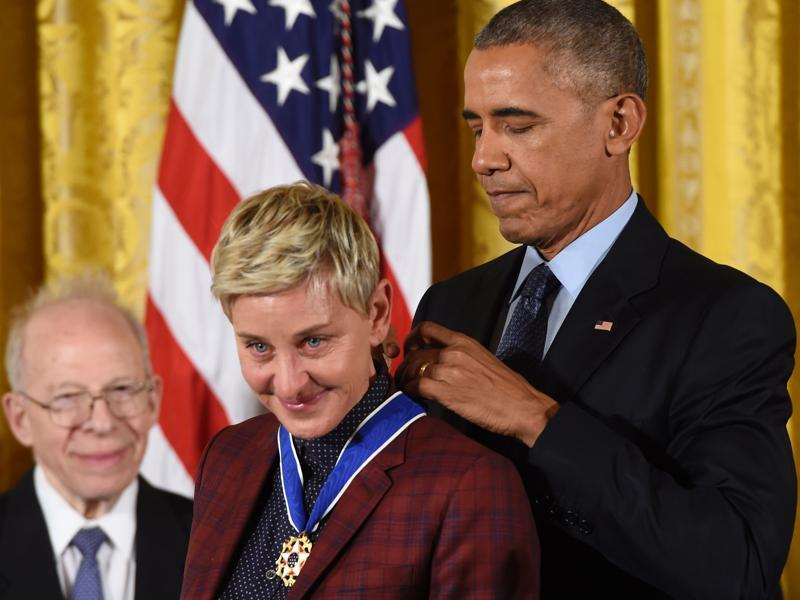 US President Barack Obama presents comedian Ellen DeGeneres with the Presidential Medal of Freedom in the East Room of the White House in Washington on November 22, 2016. Twenty one people were honoured with the medal for their contribution to their fields, including actors Tom Hanks and Robert Redford, as well as tech billionaire and philanthropist, Bill Gates. (Saul Loeb/AFP)