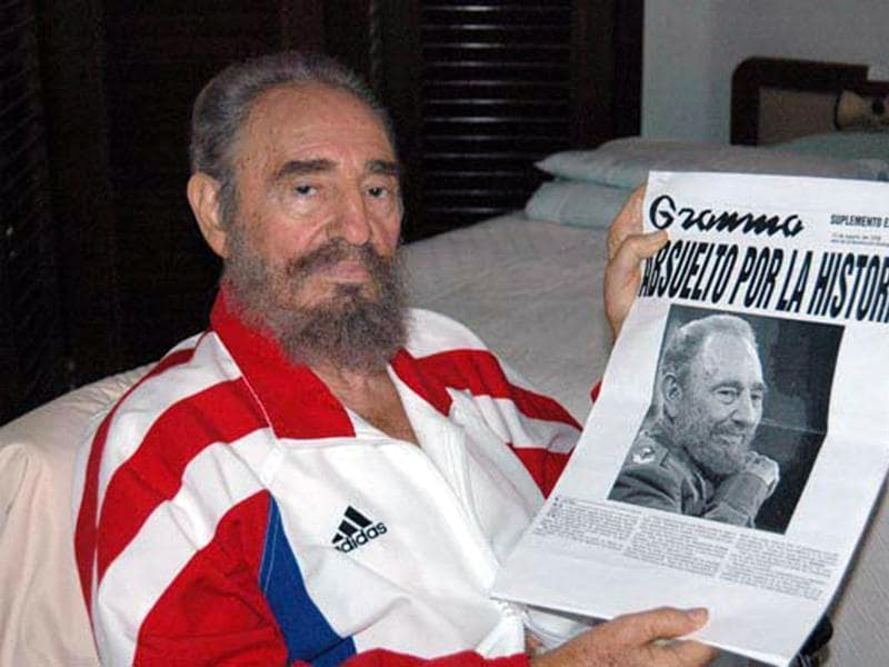 Cuban President Fidel Castro shows a copy of a newspaper in this August 13, 2006 file photo.  (REUTERS)