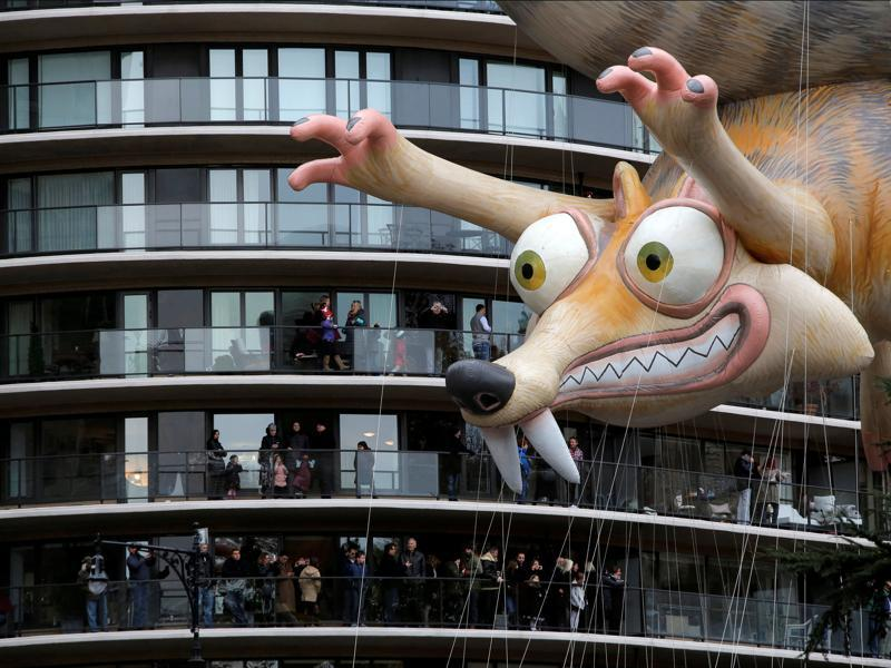 Crowds gather on terraces to see a balloon of Ice Age's Scrat float along West 59th Street during the 90th Macy's Thanksgiving Day Parade in Manhattan on November 24, 2016. (Andrew Kelly/Reuters)