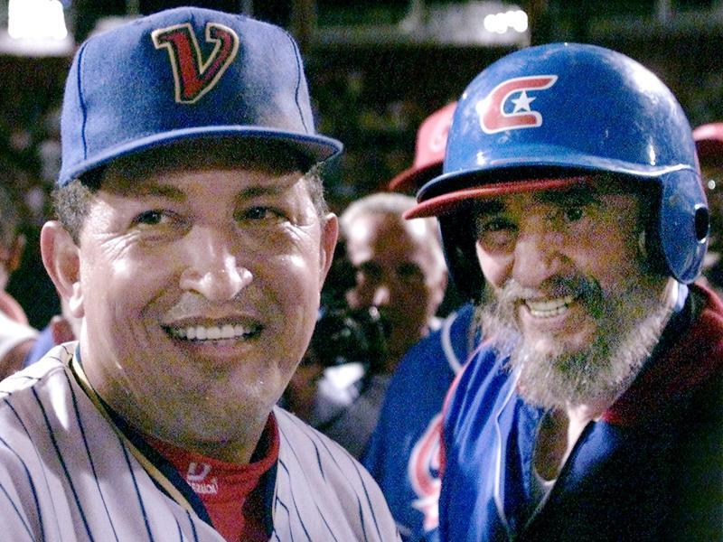 Then Cuban President Fidel Castro (R) and his Venezuelan counterpart Hugo Chavez chat on the field after taking part in a friendly baseball game between their two countries at the Barquisimeto baseball stadium in this October 29, 2000 file photo.  (REUTERS)