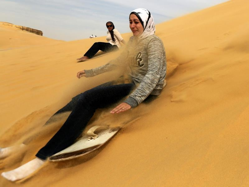 Wadi El Rayan in Egypt is a protected area in the Faiyum region of the country. A woman sandboards on the mountain in Wadi el-Rayan Fayoum. (REUTERS)
