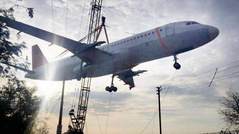 The empty Air India aircraft was being transported to the Begumpet airport for training purposes in Telangana's Hyderabad on December 25, 2016. The aircraft tipped, crashing to the ground near the airport. (PTI)
