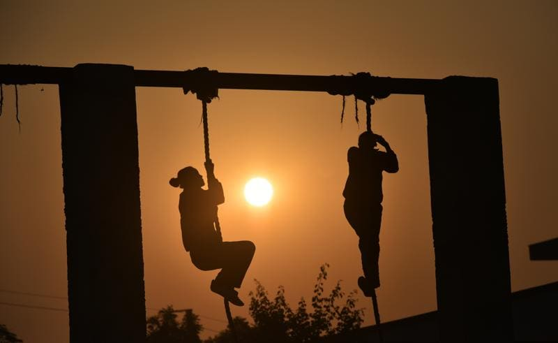 Rope climbing is one of the many tasks cadets training at the Delhi police academy in Dwarka must undergo every morning.   (Raj K Raj/HT PHOTO)