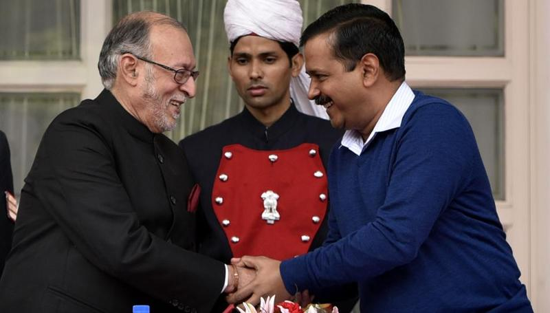 Delhi chief minister Arvind Kejriwal with Anil Baijal before Baijal's swearing-in ceremony as the new lieutenant governor of Delhi on December 31, 2016.  (Sushil Kumar/HT PHOTO)