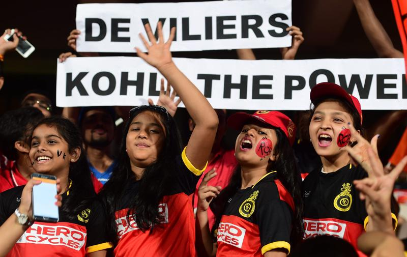RCB fans with posters cheering for Virat Kohli and AB de Villiers. (PTI)