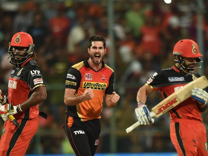 Ben Cutting (C) celebrates the wicket of Chris Gayle. (PTI)