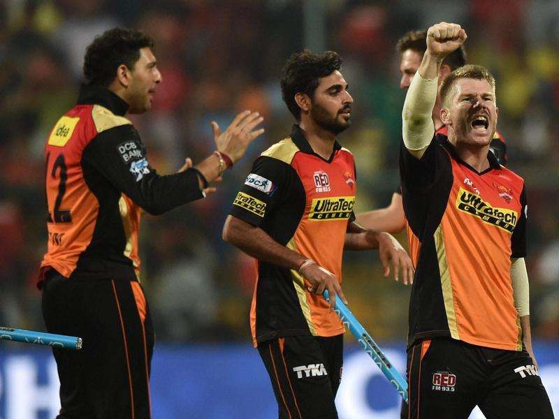Warner with a jubilant fist pump as teammates rush in to celebrate. (PTI)