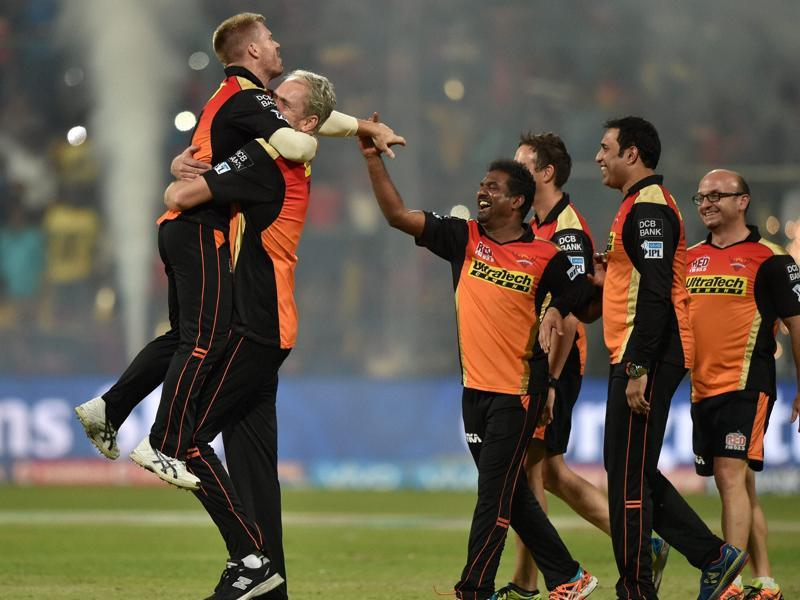Sunrisers coach Tom Moody hugs Warner as the team's support staff rush to congratulate them. (PTI)