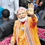 BJP workers polish people's shoes to mark Modi win