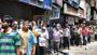 Chaos over liquor, row over migrants rail fare: Covid-19 news today