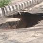 Roads cave in as heavy rain lashes Delhi