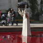 Sculpture of John Paul II throwing rock into red water makes waves