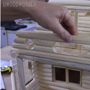 Artist creates model house with mini wooden logs, video is amazing to watch