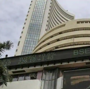 Sensex ends marginally higher; Nifty hits record peak