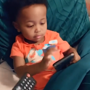 Toddler has the best reaction to being handed a remote as if it is a phone
