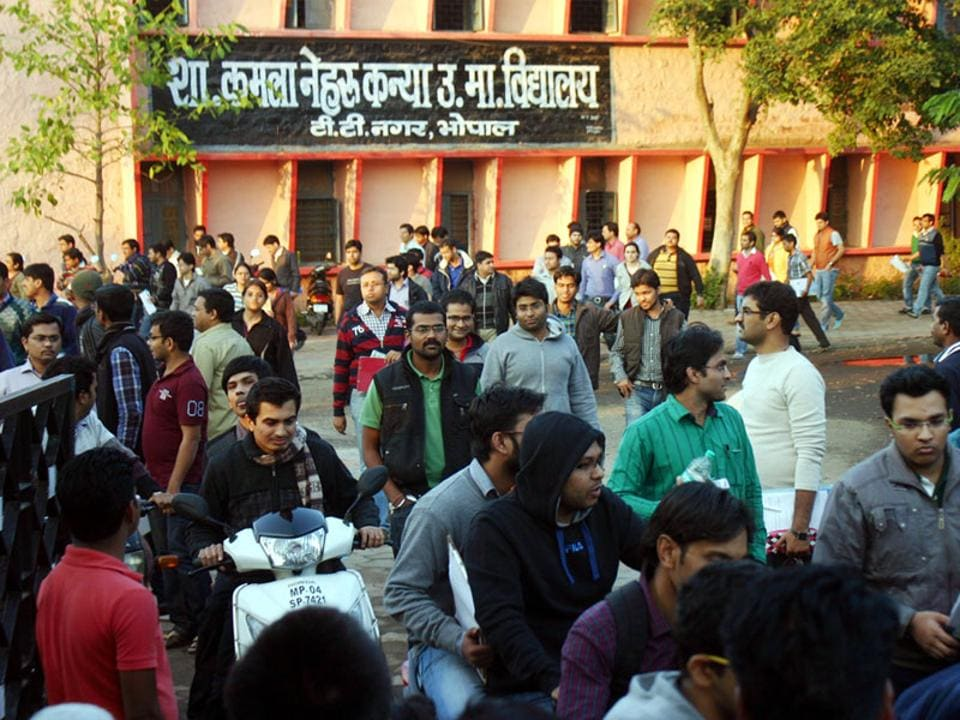 Candidates emerge from the test centre after taking the civil services examination in Bhopal.