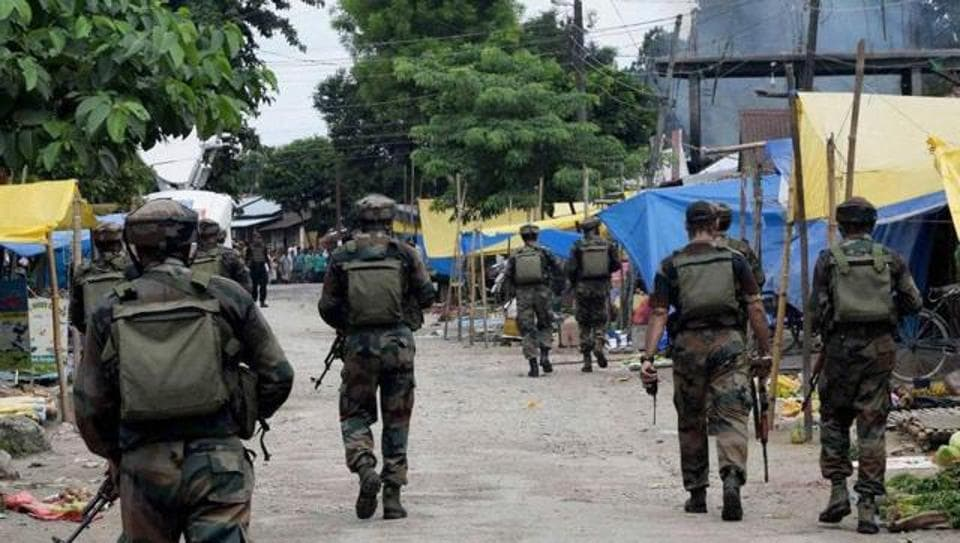 Security personnel patrolling after an attack by NDFB (S) militant in Kokrajhar in Assam.