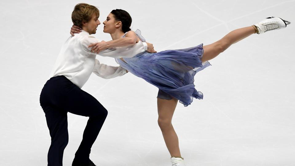 US Kaitlin Hawayek (R) and Jean-Luc Baker perform during the ice dance free dance. (AFP)
