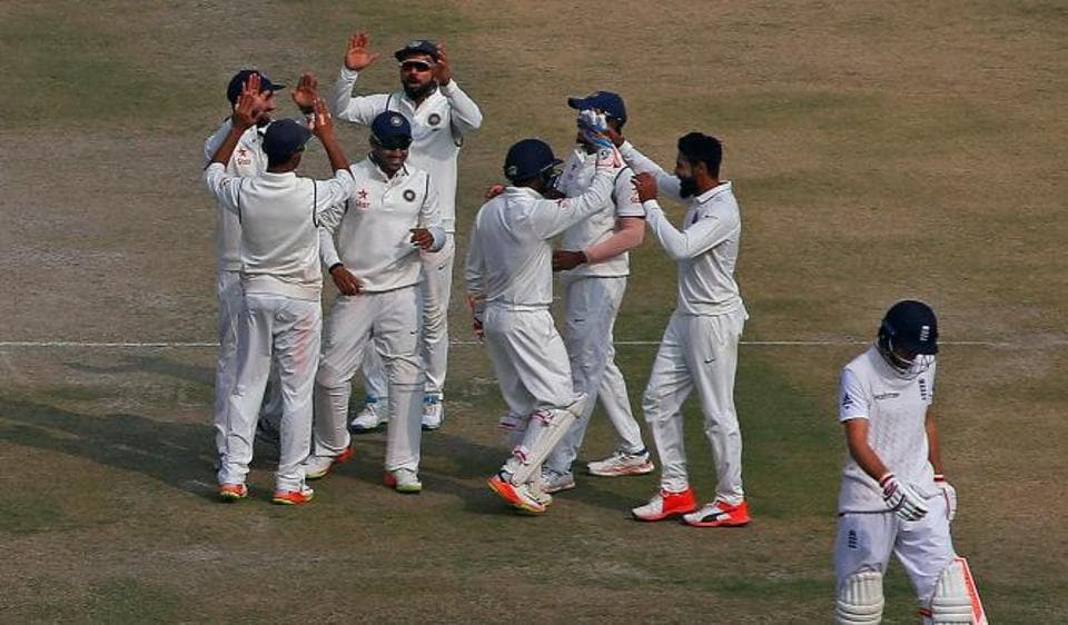 Indian players celebrate the dismissal of Joe Root on day 4 of the Mohali Test on Tuesday.