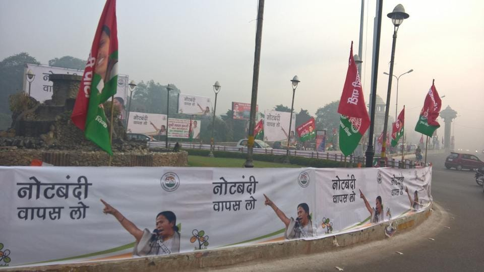 Rows of flags featuring West Bengal CM Mamata Banerjee and her Uttar Pradesh counterpart Akhilesh Yadav are seen on a road in Lucknow.