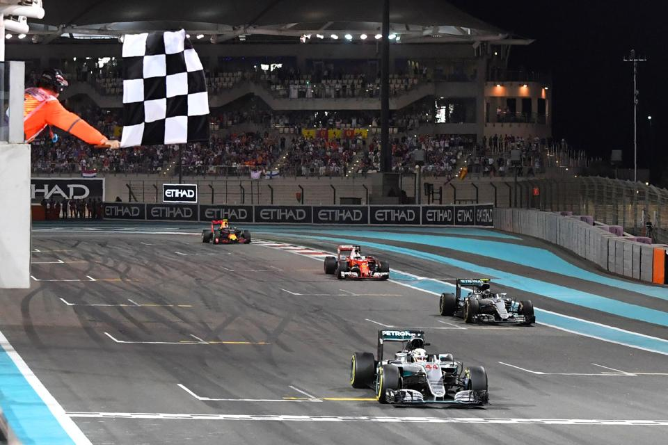 Mercedes AMG Petronas F1 Team's British driver Lewis Hamilton crosses the finish line at the end of the Abu Dhabi Formula One Grand Prix at the Yas Marina circuit on November 27, 2016.  (AFP)