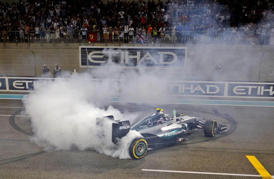 Mercedes AMG Petronas F1 Team's German driver Nico Rosberg celebrates at the end of the Abu Dhabi Formula One Grand Prix at the Yas Marina circuit on November 27, 2016.  (AFP)