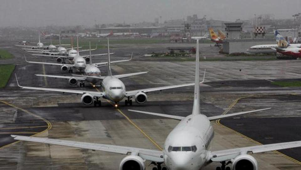 Aeroplanes lined up for take off at a domestic airport.