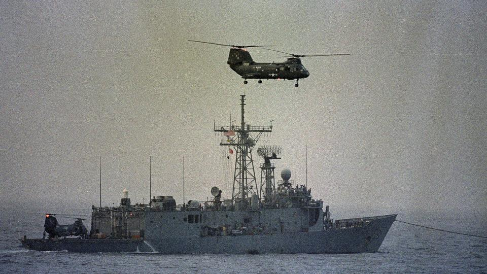 When a US Navy MH-60 helicopter flew within half a mile of two Iranian vessels in international waters, one of the vessels pointed a weapon at the helicopter, a US officials said.