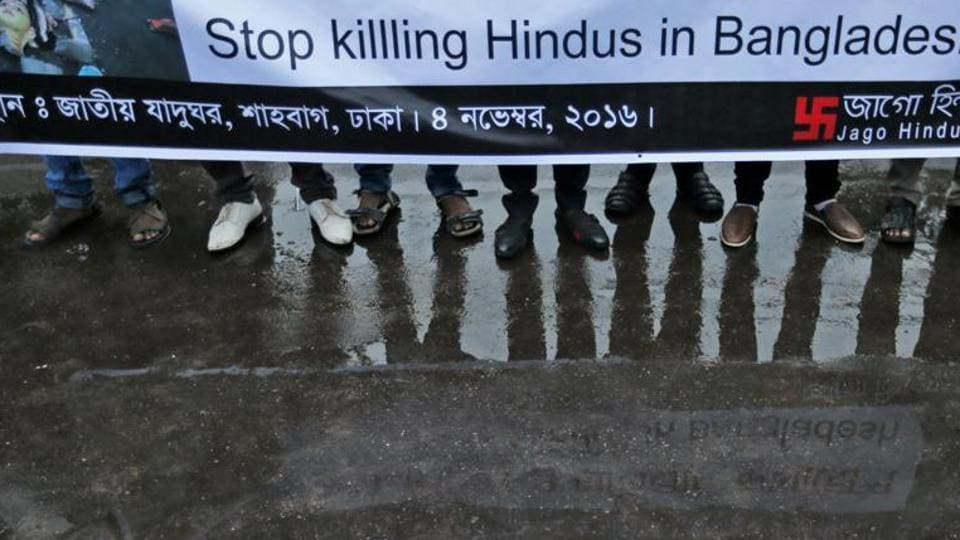 Bangladeshi social activists hold a banner and participate in a rally held to protest against recent communal violence in the country, in Dhaka, Bangladesh, Friday, Nov. 4, 2016.