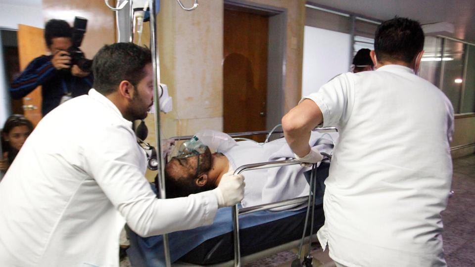 Brazilian soccer player Alan Luciano Ruschel of Chapecoense soccer club receives medical attention after a plane crash in Antioquia, central Colombia.