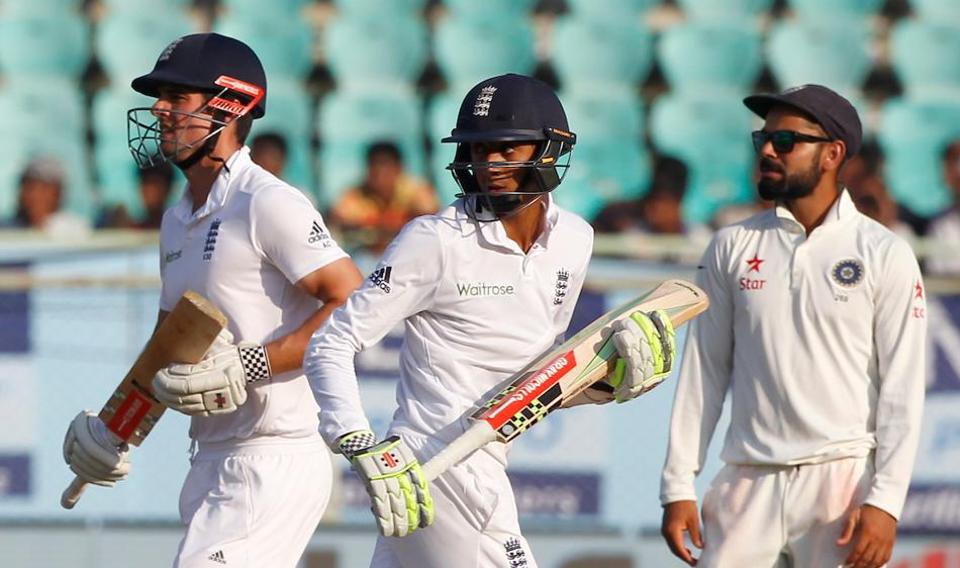 Haseeb Hameed and Alastair Cook run between the wickets during Vizag Test as Virat Kohli watches