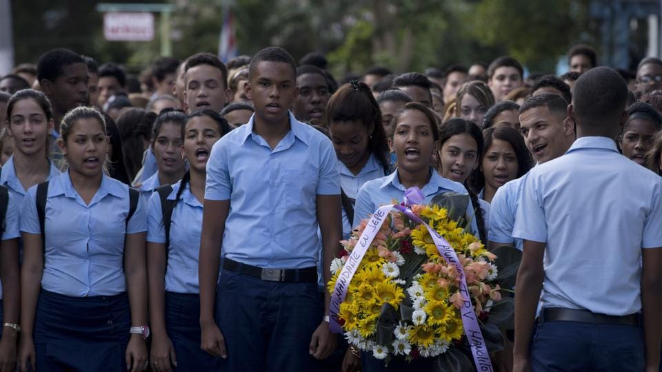 Students march, one carrying a wreath, to a memorial honoring the late Fidel Castro, in the Ciudad Escolar Libertad neighborhood in Havana, Cuba, Monday, Nov. 28, 2016. Cubans on Monday began bidding farewell to Castro, the man who ruled the island for nearly half a century. Cuba's government has declared nine days of national mourning following Castro's death Friday night at age 90.  (AP)