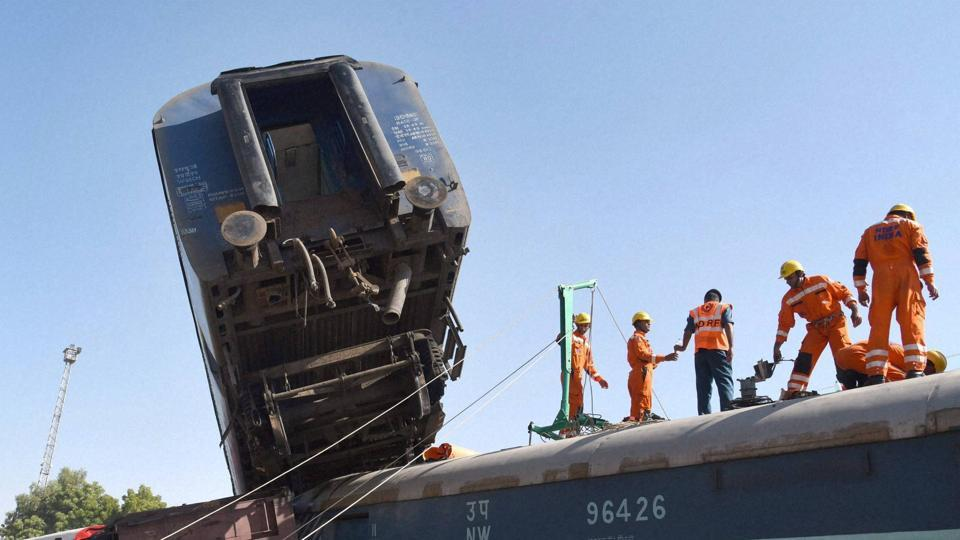 Disaster management personnel carry out a mock drill for rescuing people during accidents at Lalgarh Railway station in Bikaner on Monday. (PTI Photo)