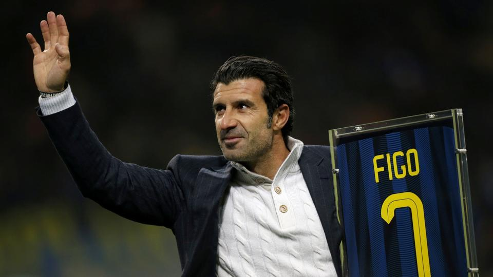 Former Inter Milan's player Luis Figo waves as he holds his jersey prior to the match. (AFP)