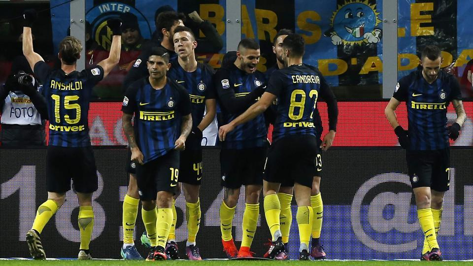 Inter Milan's Argentinian forward Mauro Emanuel Icardi (C) celebrates with his teammates after scoring a goal during the Italian Serie A football match between Inter Milan and Fiorentina on November 28. (AFP)
