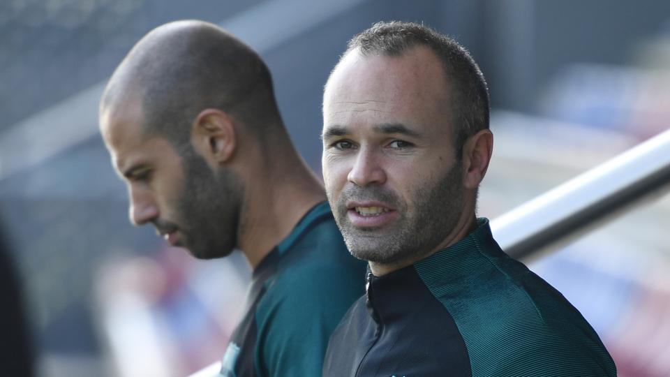 Andres Iniesta damaged knee ligaments last month and returned to training on Friday.