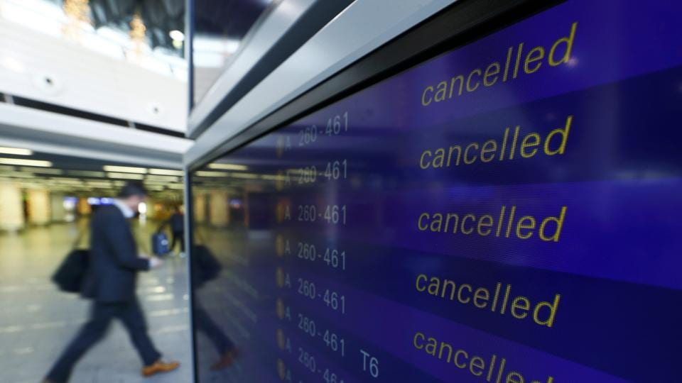 A passenger walks past a flight information board showing cancelled flights during a pilots strike of German airline Lufthansa at Frankfurt airport, Germany, November 23, 2016.