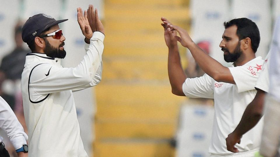 India captain Virat Kohli celebrates with Mohammed Shami the wicket of England batsman Adil Rashid, on the fourth day of the third Test match between India and England in Mohali on Tuesday. PTI Photo by Vijay Verma(PTI11_29_2016_000081B)