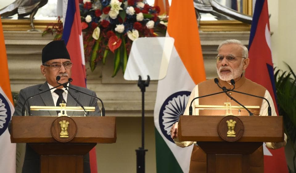 Prime Minister Narendra Modi (right) speaks during a joint press conference with Nepalese Prime Minister Pushpa Kamal Dahal following a meeting in New Delhi on September 16.