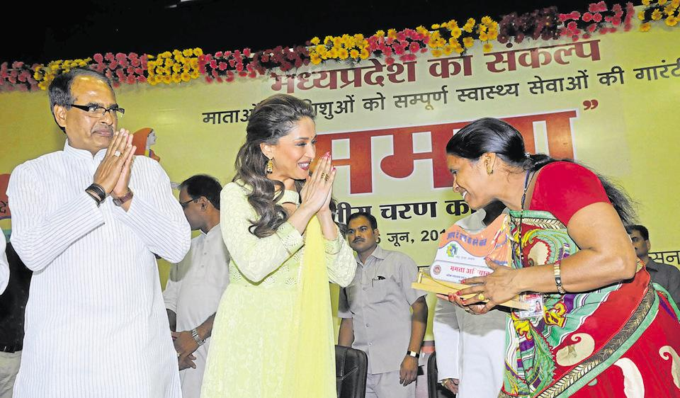 Bollywood actress Madhuri Dixit along with chief minister Sihuvraj Singh Chouhan felicitating an ASHA worker during launch of Mamta campaign in Bhopal.