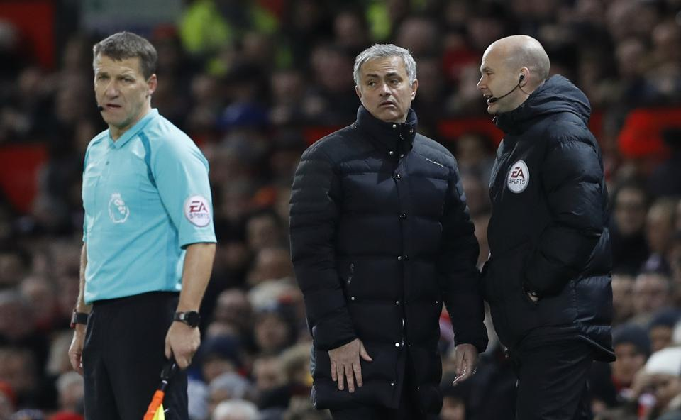 Manchester United manager Jose Mourinho with fourth official Anthony Taylor before being sent to the stands during the match against West Ham.