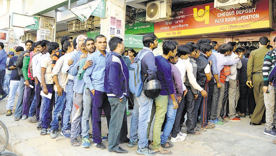 People queue up outside the Punjab National Bank Sector-10A branch to withdraw the cash.