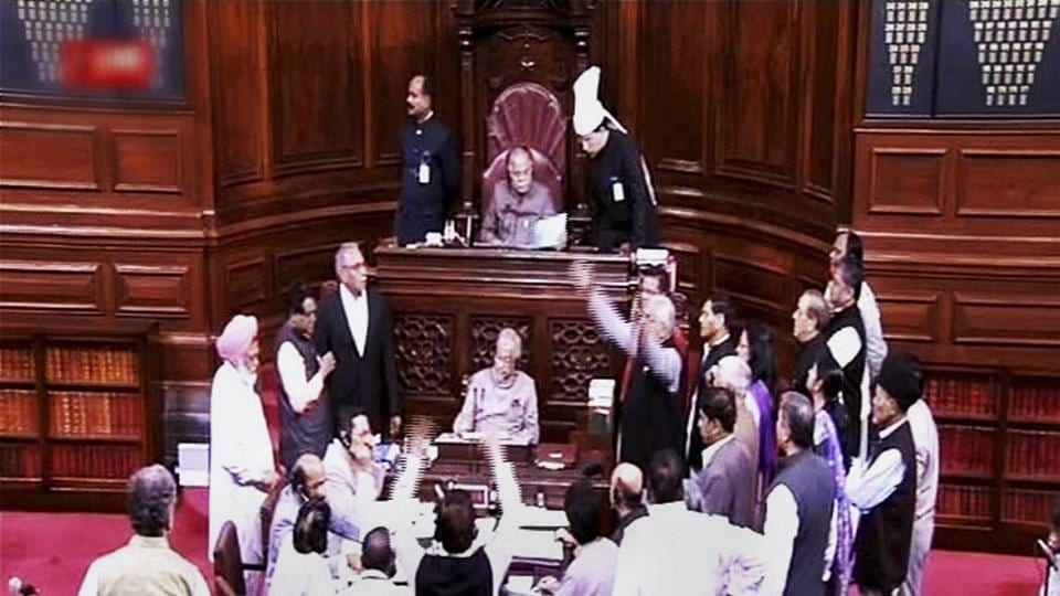 Opposition members holding a protest in the well of Rajya Sabha in New Delhi.