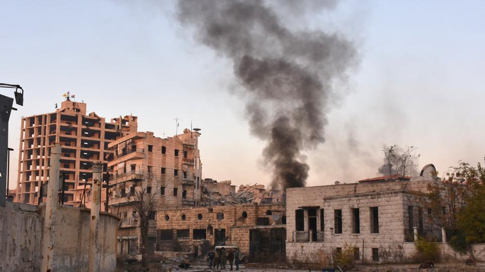 Smoke billows in Aleppo's Bustan al-Basha neighbourhood on November 28, 2016, during Syrian pro-government forces assault to retake the entire northern city from rebel fighters. Government forces have retaken a third of rebel-held territory in Aleppo, forcing nearly 10,000 civilians to flee as they pressed their offensive to retake Syria's second city.   (AFP)